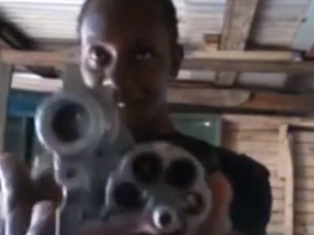 Jamaican Man Records Himself Showing Off His Guns